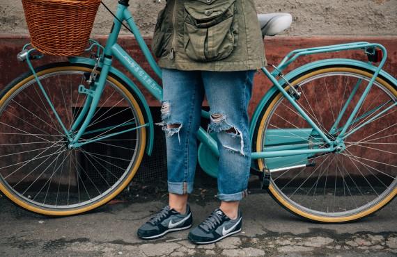 The Girl Racing Bicycle